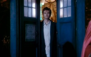 David Tennant in his debut as The Doctor, looking out of the Tardis