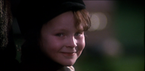 The young Damien Thorn, smiling.